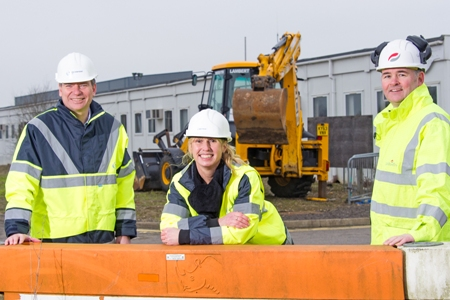 Stansted Airport's Head of Construction and Development, Matt Allen (left), is pictured  at the construction site with Aerozone Education Co-ordinator Joanne Davies (centre) and Bernie Kelly (right) of Galliford Try.